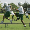 Ray Copeland, a football coach at Bishop McGuinness High School, puts his players through a workout in Oklahoma City in 2007. As is often the case in much of the U.S., the first day of high school football practice that year began in a heat wave.