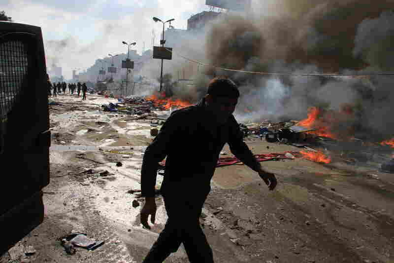 Egyptian security forces clash with Morsi supporters in the Nasr City. Backed by armored cars and bulldozers, the security forces moved to clear the two camps.