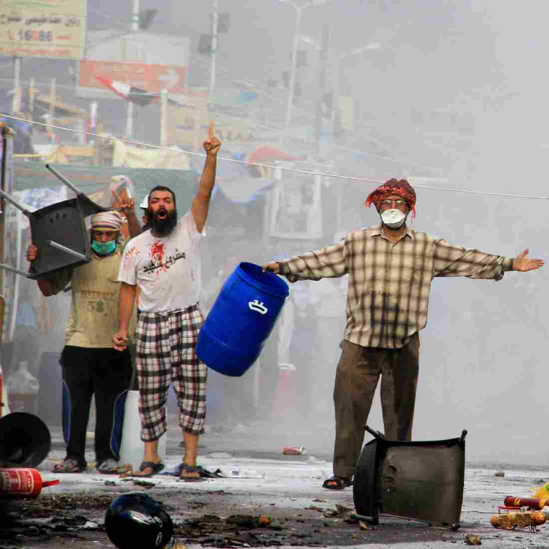 Protesters taunt security forces moving in to clear one protest camp near the Rabaa al-Adawiya mosque in Cairo. The military-backed government described the camps as violent and unlawful.