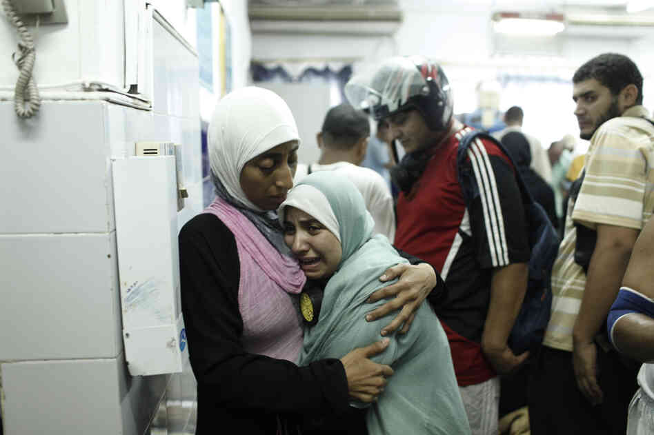 A Morsi supporter reacts after identifying the body of a dead family member at of the Rabaa al-Adawiya Medical Center in the Nasr City. The Egyptian ministry of health reported 275 people had been killed and 2,001 had been injured across the country. The government said 43 policemen had been killed.