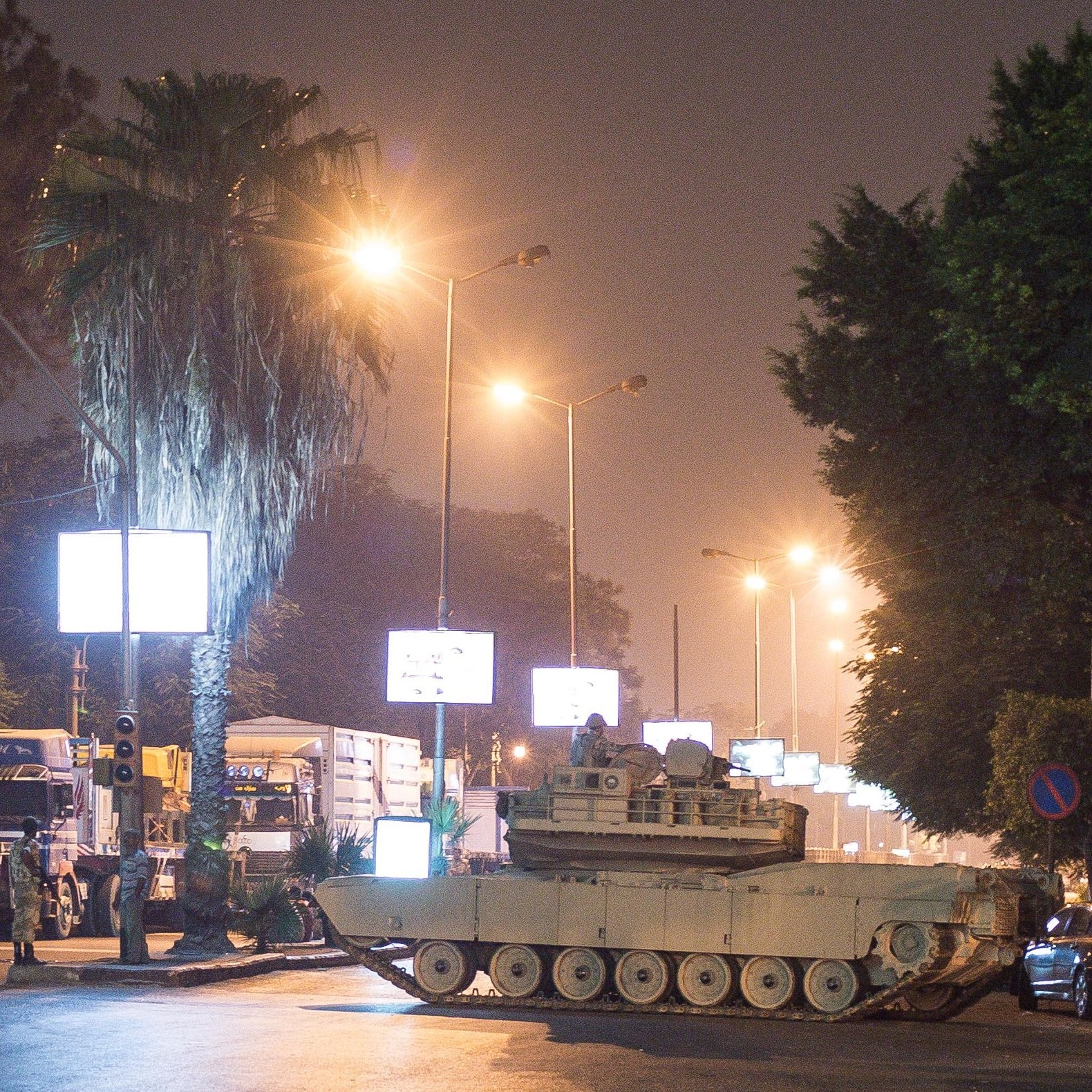 Two Egyptian army tank block a street during the first day of curfew in Cairo, Egypt on Wednesday. Egyptian police in riot gear swept in with armored vehicles and bulldozers to clear two encampments of Morsi supporters.