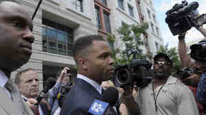 Former Illinois Rep. Jesse Jackson Jr., leaves federal court in Washington, D.C. on Wednesday. Jackson was sentenced to two and a half years in prison Wednesday after pleading guilty to scheming to spend $750,000 in campaign funds on TV's, restaurant dinners, an expensive watch and other costly personal items.