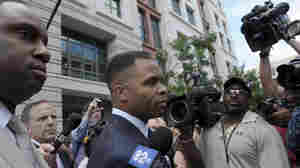 Former Illinois Rep. Jesse Jackson Jr., leaves federal court in Washington, D.C. on Wednesday. Jackson was sentenced to two and a half years in prison Wednesday after pleading guilty to scheming to spend $