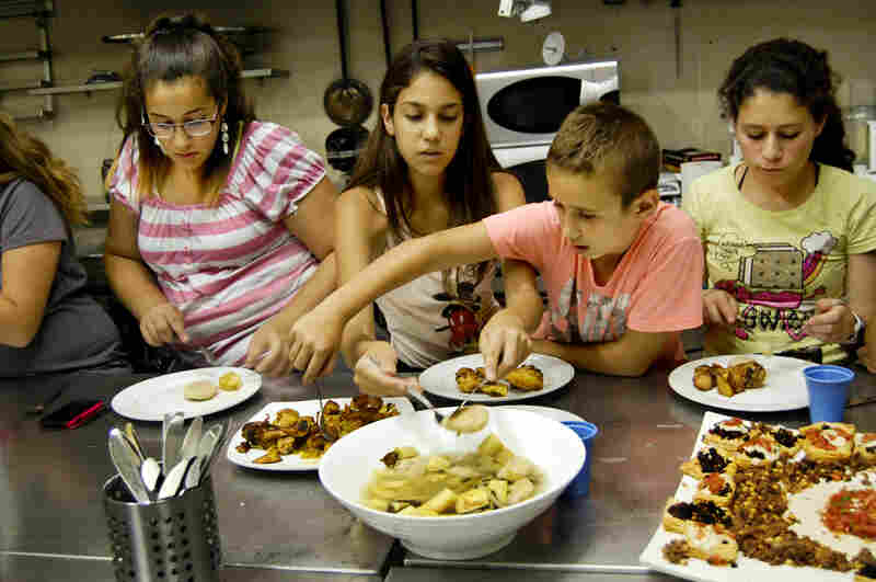 At the Te'amim — or Tastes — cooking camp in Jerusalem, kids dig into a big bowl of kubbeh hamusta, a popular dumpling they learned to make.