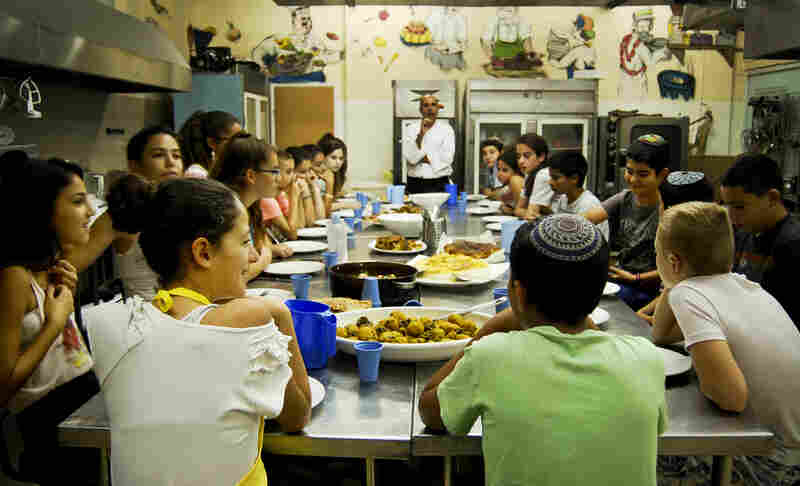 Before the campers can dig into the comfort food they made, Shlomi shares a bit of history about each dish. Like hummus, kubbeh is one of those dishes that is well loved, with local varieties from Iraq to Egypt.