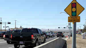 """Traffic engineers face """"a new conundrum"""" in dealing with red-light cameras such as this one in New Mexico, according to a recent study looking at how cameras are operated and the perception that they are used to generate revenue."""