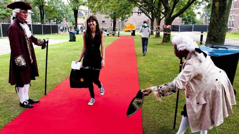 A first-year student is greeted upon arrival at University College in Utrecht, Netherlands, on August 16, 2010.