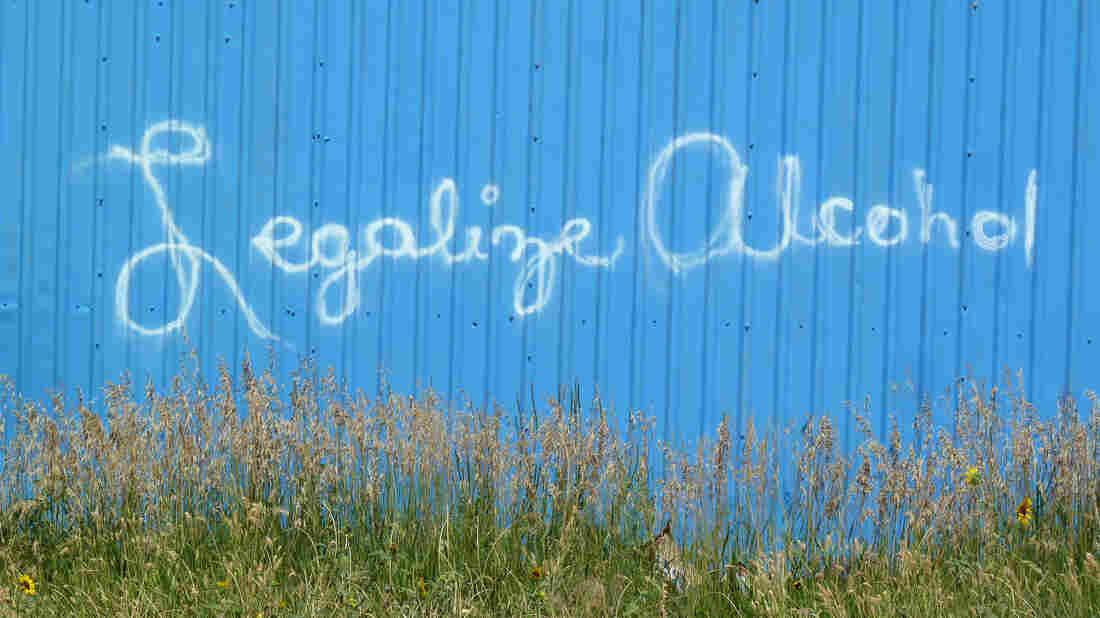 A sign on a building in Whiteclay, Neb., urging Pine Ridge Indian Reservation residents to approve the legalization of alcohol sales.