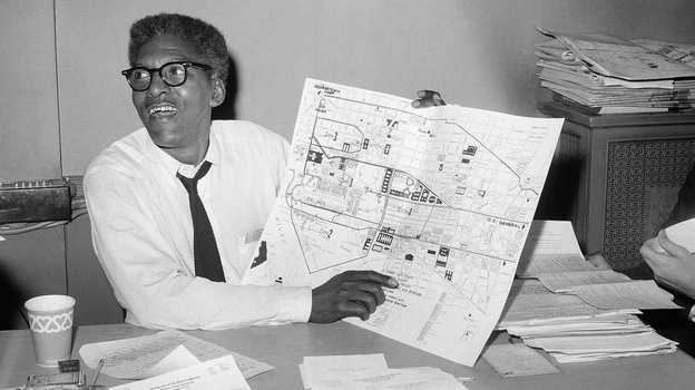 Activist Bayard Rustin points to a map during a press conference four days ahead of the March on Washington in August 1963. (AP)