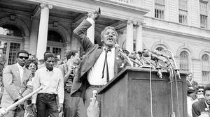 Bayard Rustin speaks in front of City Hall in New York on May 18, 1964, at a rally for school integration.