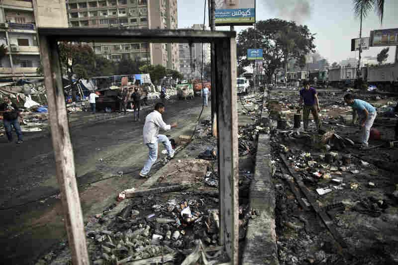 Egyptians search through the debris at Rabaa al-Adawiya square.