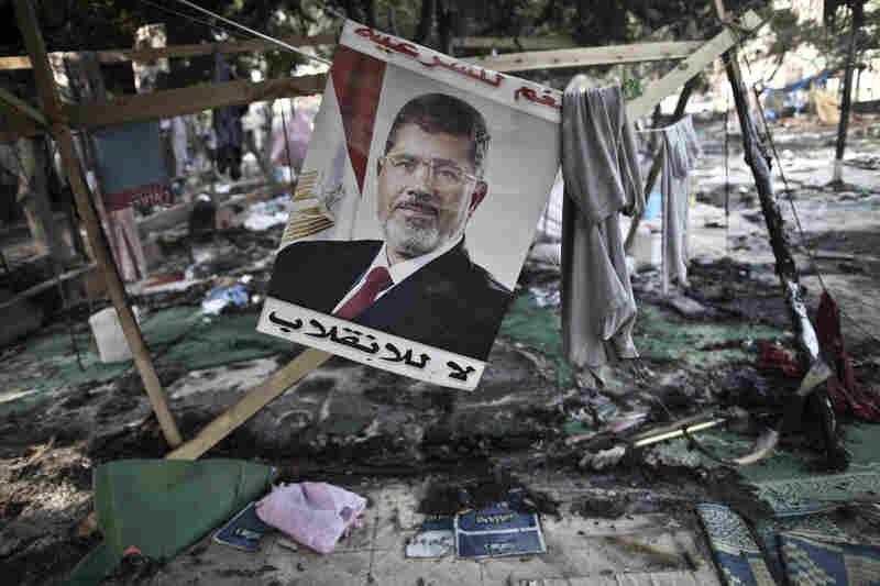 A picture of Morsi is seen hanging amid debris at Rabaa al-Adawiya square.