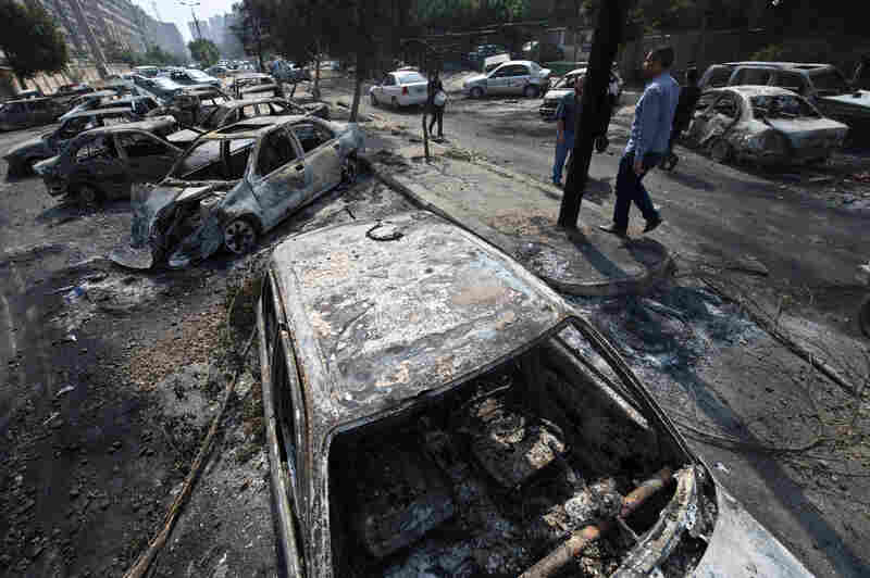 The destroyed camp of Morsi supporters outside the Rabaa al-Adawiya mosque. The raids prompted the military-backed interim leaders to impose a state of emergency and curfew, and drew widespread condemnation from around the world.