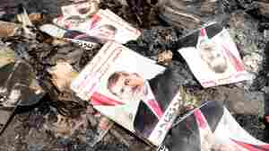 Posters of ousted Egyptian President Mohammed Morsi lay amid the rubble of a protest camp in Cairo after Wednesday's crackdown by government forces.