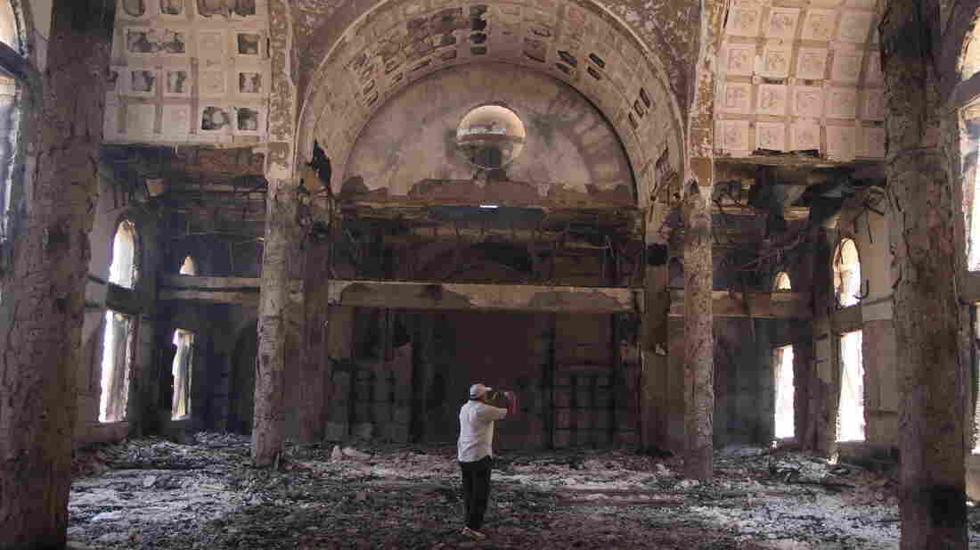 The damaged interior of the Saint Moussa Church is seen Thursday, a day after it was torched in sectarian violence in Minya, south of Cairo.