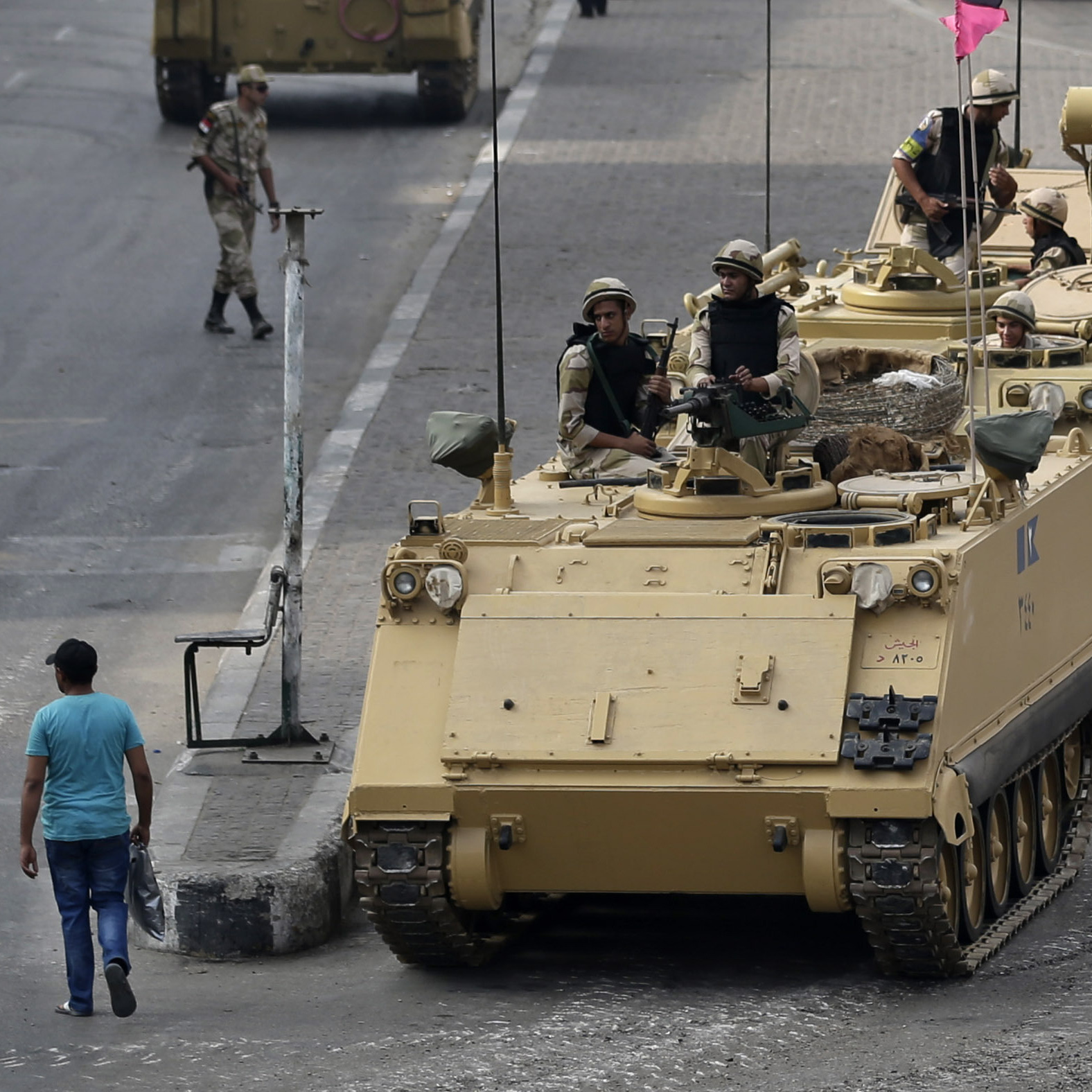 Soldiers take their positions on armored vehicles while guarding an entrance to Tahrir Square in Cairo. Wednesday's crackdown left more than 600 people dead and nearly 4,000 injured.