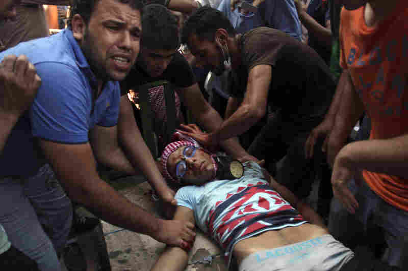 A wounded man is evacuated during clashes between security forces and Morsi supporters in Cairo.