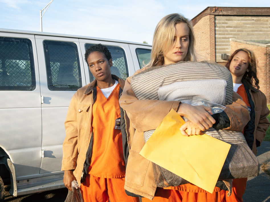 Janae Watson (Vicky Jeudy), Piper Chapman (Taylor Schilling) and Dayanara Diaz (Dascha Polanco) arrive in prison in the first episode of <em>Orange Is the New Black</em>.