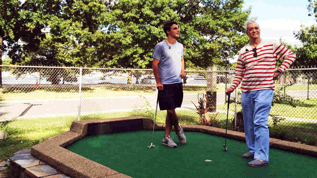 Dylan Dethier and NPR's Scott Simon enjoy a round of putt-putt golf at the East Potomac G