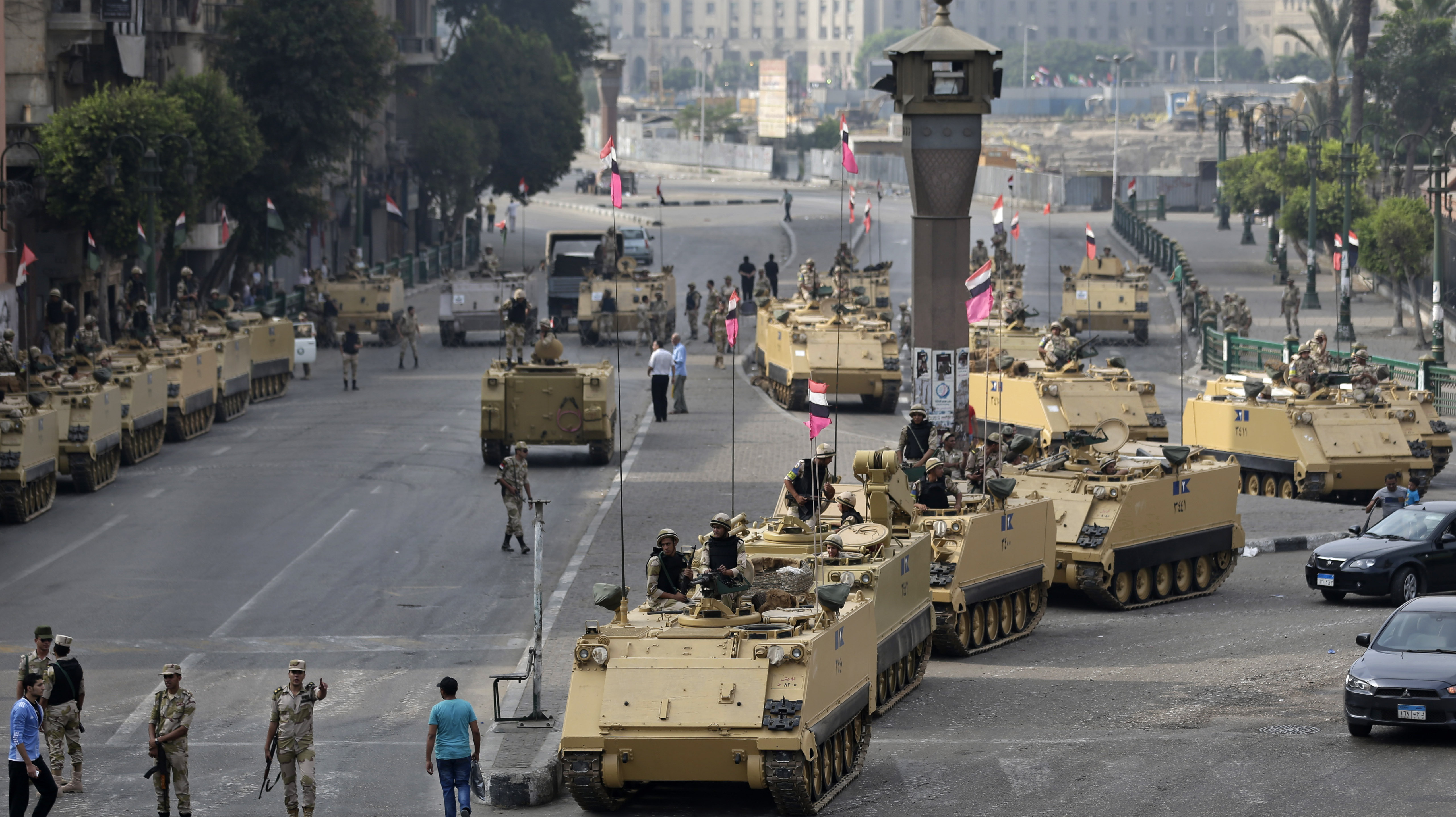 Egyptian army soldiers take their positions on top and next to their armored vehicles while guarding an entrance to Tahrir square in Cairo on Friday.