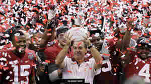 Alabama head coach Nick Saban celebrates with his team after defeating LSU 21-0 in the BCS National Championship game on Jan. 9, 2012, in New Orleans.
