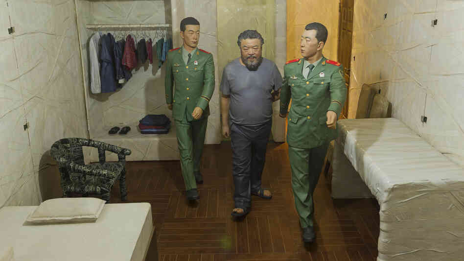 One of Ai Weiwei's dioramas shows guards leading him into his small cell where h