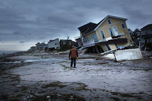Damage is viewed in the Rockaway neighborhood where the historic boardwalk was washed away during Hurricane Sandy on October 31, 2012.