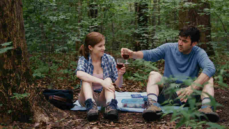 Luke and Kate's significant others — Jill (Anna Kendrick) and Chris (Ron Livingston), respectively — have a flirtation of their own.