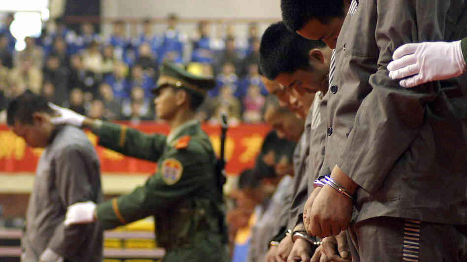 Chinese police show a group of convicts at a sentencing rally in the city of Wenzhou on April 7, 2004. Eleven prisoners were later executed for various crimes. Since then, the number of executions in China has significantly declined.
