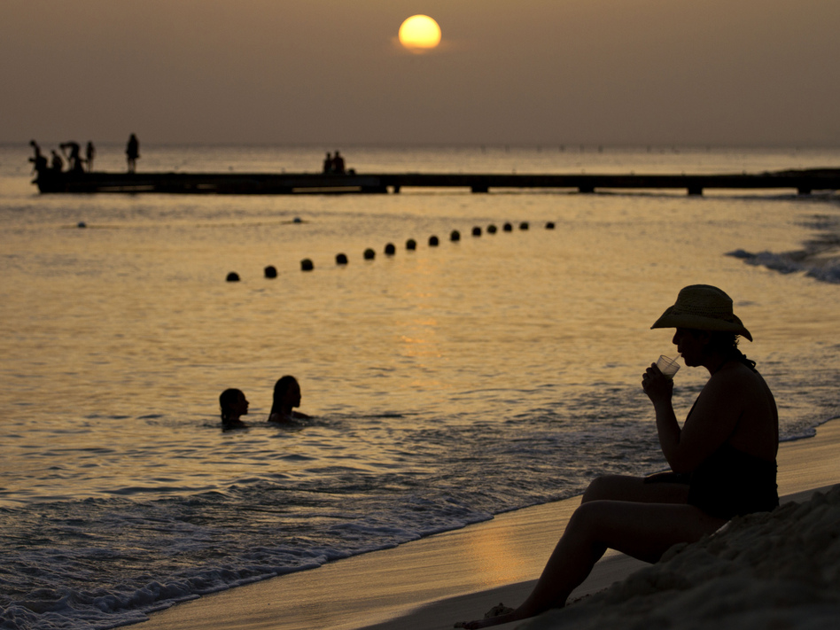 A person has a drink at Dominicus beach in Bayahibe, La Altagracia province, Dominican Republic. (Erika Santelices/AFP/Getty Images)