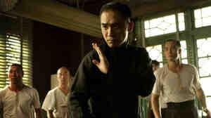 Tony Leung (center) fends off challengers as Wing Chun kung fu master Ip Man in Wong Kar Wai's The Grandmaster.