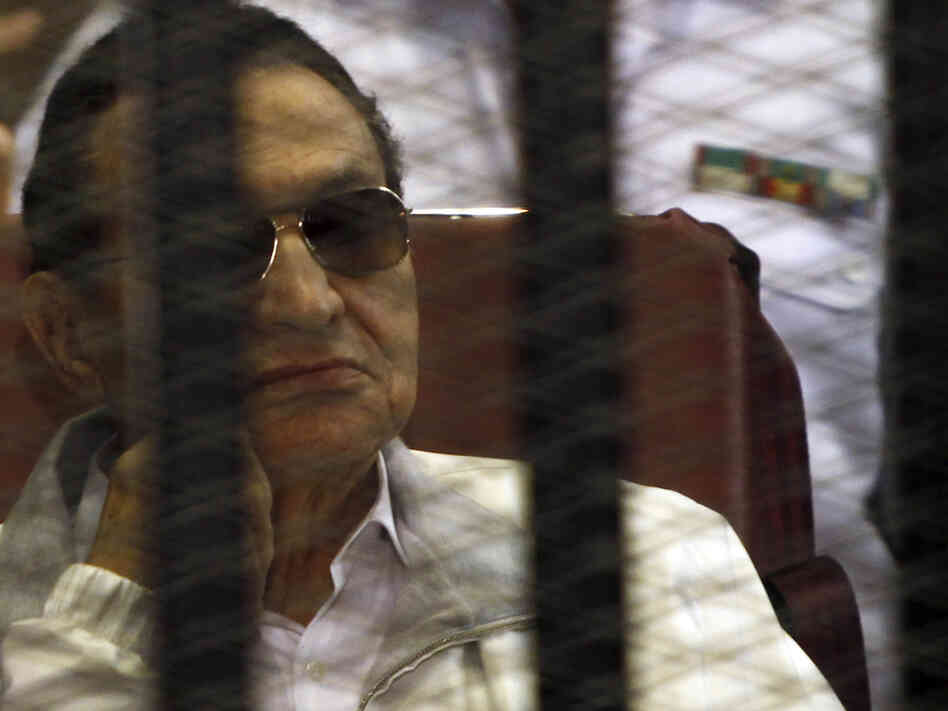 Former Egyptian President Hosni Mubarak sits in the dock during a court hearing in Cairo on June 8.