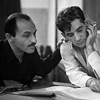 Composer Marc Blitzstein (left) with Leonard Bernstein studying the score of a Blitzstein work during a 1947 recording session.