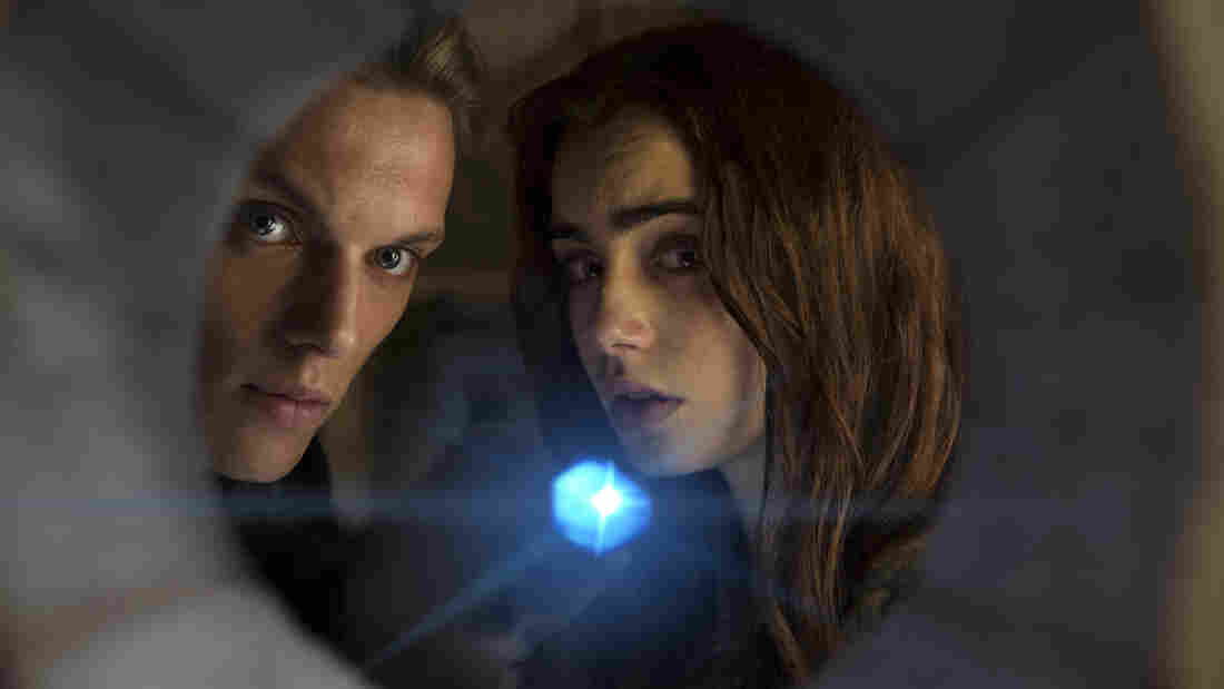 Jace (Jamie Campbell Bower) and Clary (Lilly Collins) are Shadowhunters — they are teens, and they are special — in the first of a threatened series of half a dozen films based on Cassandra Clare's Mortal Instruments novels for young adults. Or perhaps, at 2 hours 10 minutes, this is all six films. We may have misunderstood.