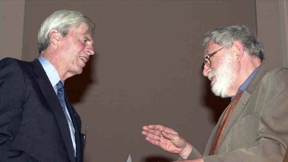 John Hollander (right) inducts George Plimpton into the American Academy of Arts and Letters at a 2002 ceremony in New York.