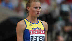 Sweden's Emma Green Tregaro sports red nails as she waits to compete in the women's high jump final at the 2013 IAAF World Championships in Moscow. Green Tregaro was told her rainbow-colored nail violated track's rules against political stat