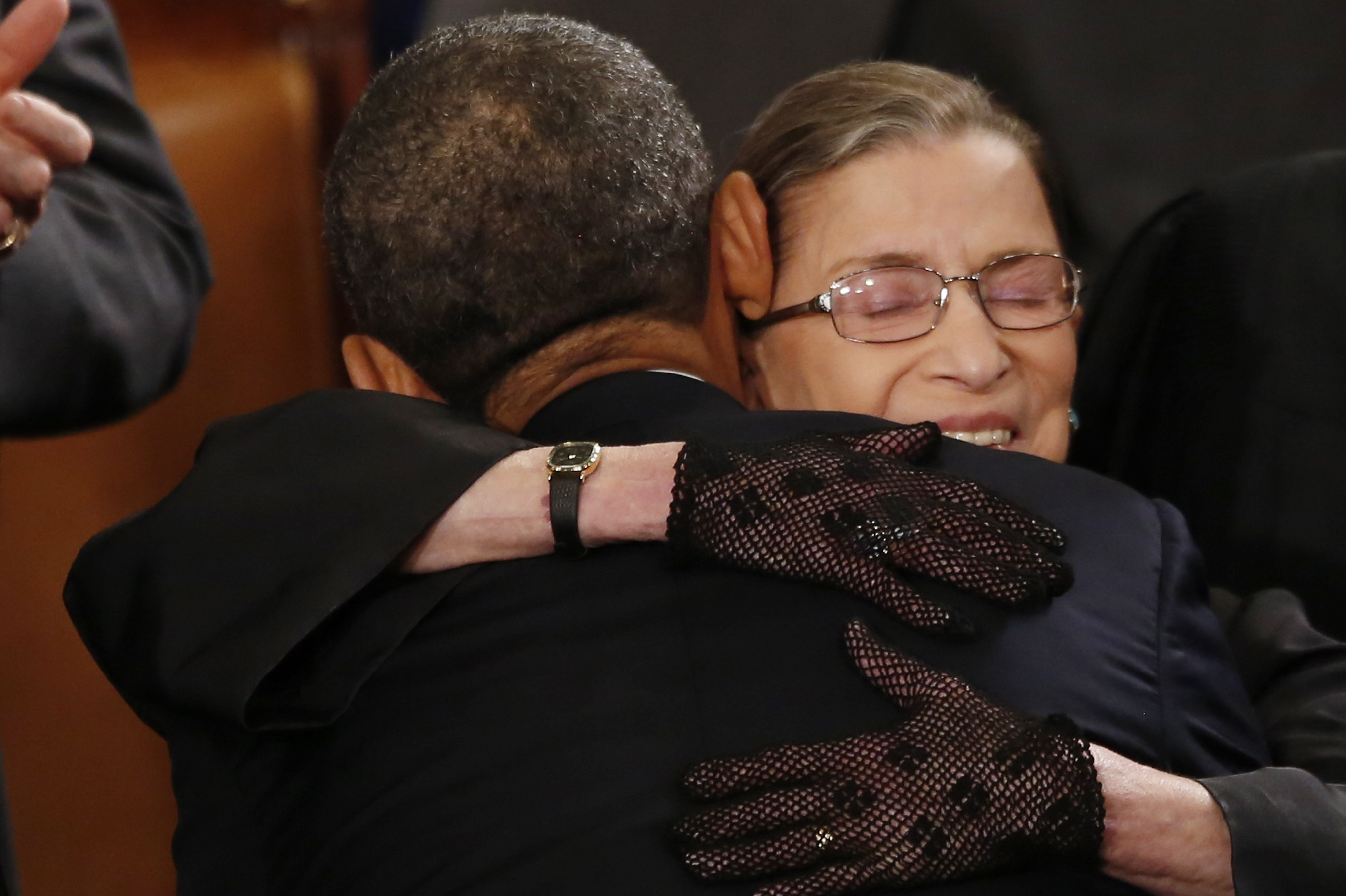 Ginsburg hugs President Barack Obama as he arrives to deliver his State of the Union speech on Capitol Hill on Feb. 12, 2013.