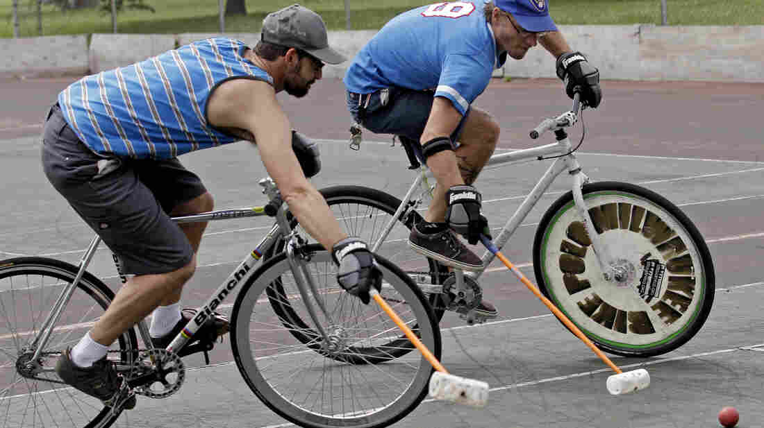 Jacob Newborn takes a shot past Lodewijk Broekhuizen (left) during a bike polo practice session in Milwaukee.