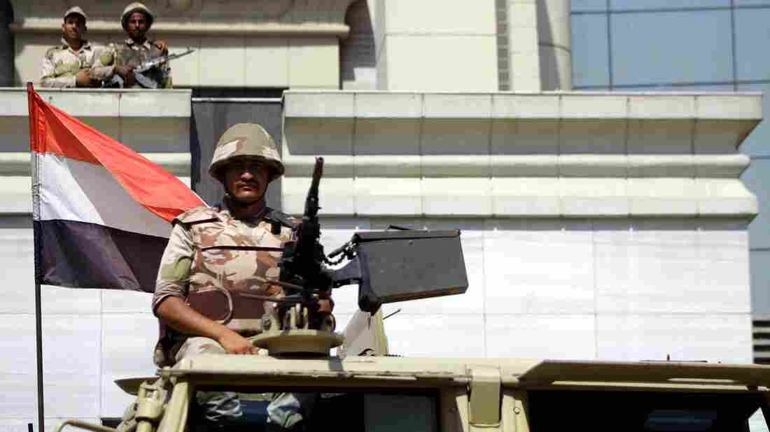 Egyptian soldiers stand guard in front of the constitutional court in Cairo.