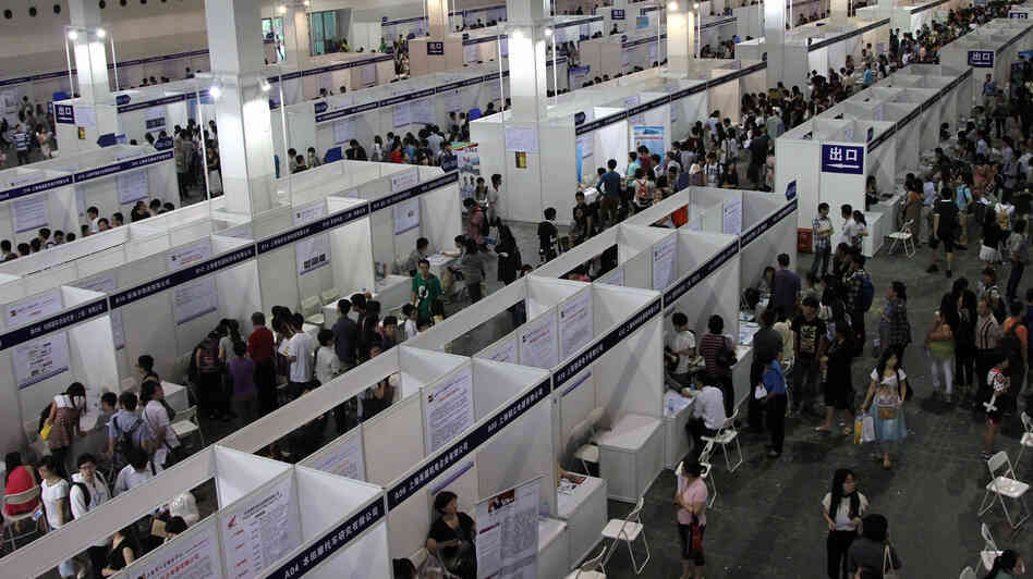 Thousands descended on a job fair in Shanghai earlier this year. This summer nearly 7 million people graduated from Chinese colleges, but jobs are harder to find than in previous years.