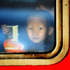 A child eats instant noodles on a train at the Harbin Railway Station in northeast China.