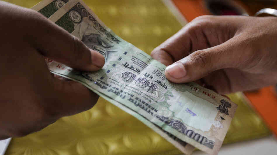 The Indian rupee has fallen nearly 16 percent against the dollar since May. The drop comes amid a slowdown in the country's economy. India's troubles are mirrored in other emerging economies that drove global growth for the past decade.