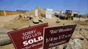 Toll Brothers luxury homes are shown sold before construction is completed in Oceanside, Calif. On Wednesday, Toll Brothers reported a 24 percent jump in quarterly revenue due to higher home prices.