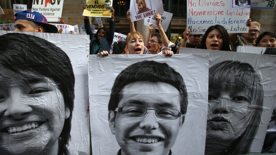 """Immigration reform advocates hold signs of young immigrant """"dreamers"""" during a protest outside a fundraising event for Texas Sen. Ted Cruz at the Grand Hyatt Hotel in New York City on May 29."""