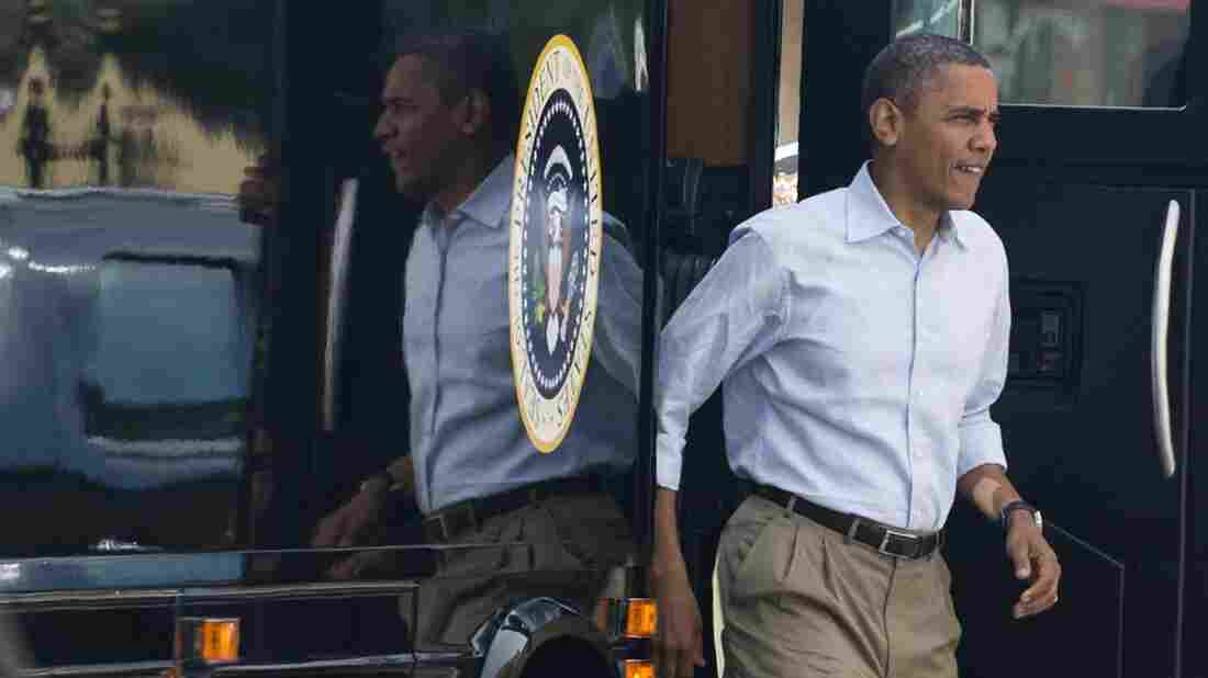 """President Obama steps off his bus, nicknamed """"Ground Force One,"""" as he arrives for breakfast at the Ossorio Bakery and Cafe in Cocoa, Fla., during a two-day bus tour last year."""