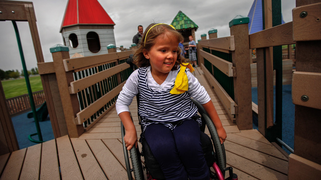 Brooklyn Fisher rolls down the ramp on the playground named for her in Pocatello, Idaho. The playground was built using accessible features so children of all abilities could play alongside each other. (NPR)