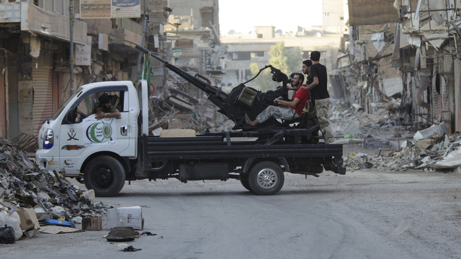 Free Syrian Army fighters man an anti-aircraft gun on the back of a truck in Deir al-Zor on Tuesday. (Reuters/Landov)