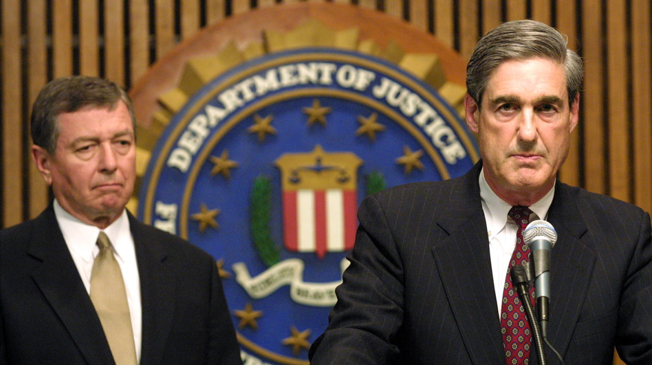 FBI Director Robert Mueller had been on the job just a week before the terrorist attacks of Sept. 11, 2001. On Sept. 12, he took questions from reporters with U.S. Attorney General John Ashcroft about the investigation. (Getty Images)
