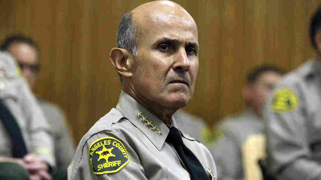 Los Angeles County Sheriff Lee Baca at the Men's Central Jail in downtown LA in 2012. Baca, who has been under fire for jailhouse abuses, is facing calls to step down and not seek a fifth term.