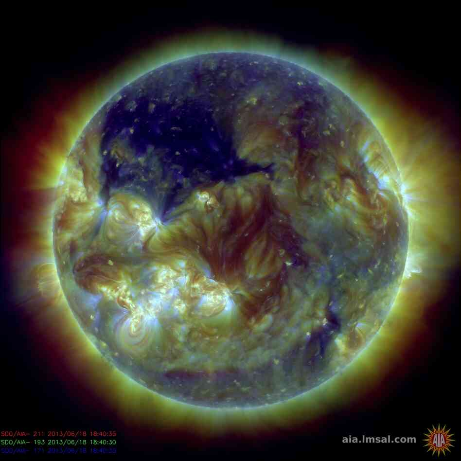 NASA's Solar Dynamics Observatory captured this picture of the sun on June 18. The dark blue area in the upper left quadrant of the sun is a huge coronal hole more than 400,000 miles across. Coronal holes are areas of the sun's outermost atmospheric layer — the corona — where the magnetic field opens up and solar material quickly flows out.